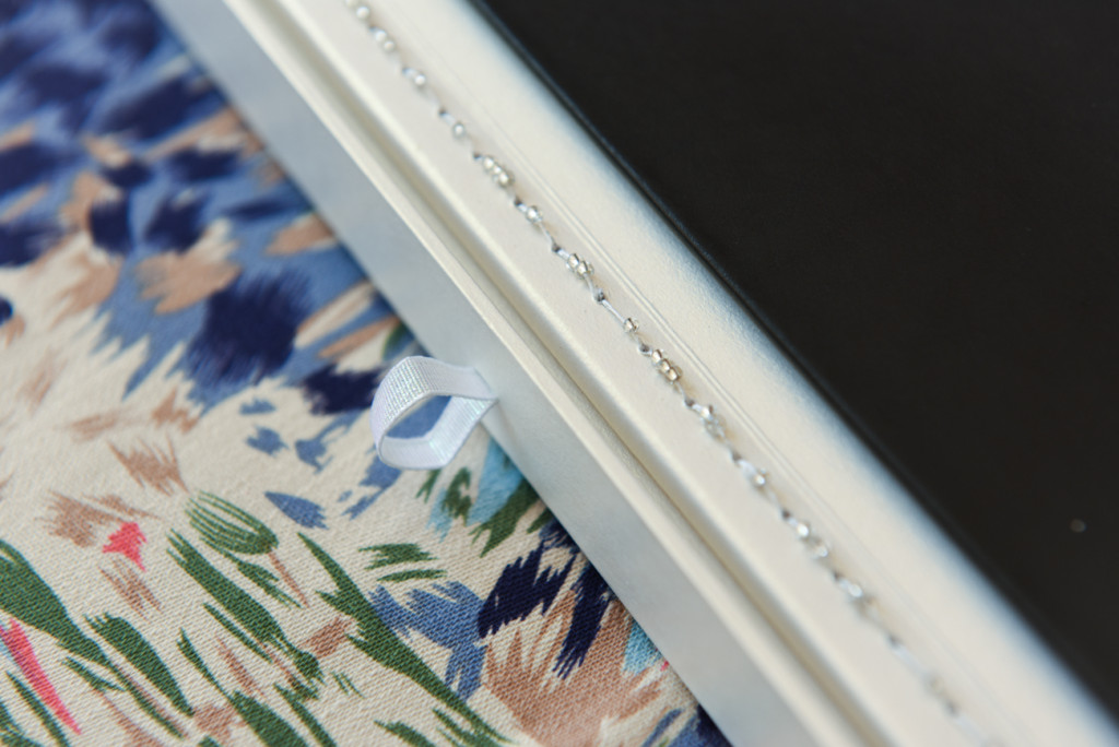 Made in Paris wedding album by Anais Chaine Photography detail of pearl and silver sewing