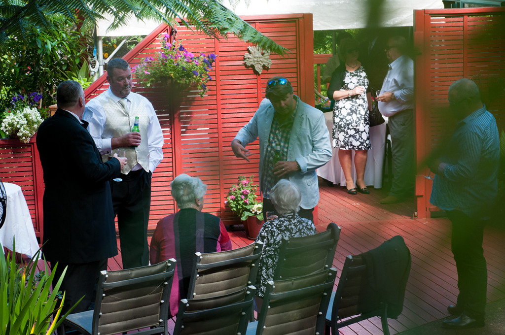 Couple chatting with guests Homosexual Home garden Wedding Auckland Photographer Anais Chaine