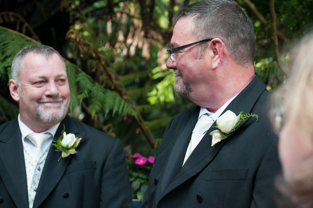 The grooms smiling at each other Homosexual Home garden Wedding Auckland Photographer Anais Chaine