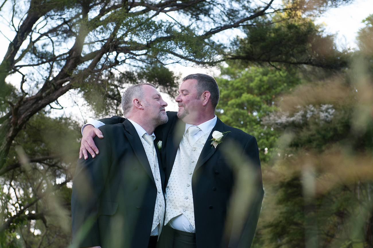 The lovely couple gazing at each other Homosexual Home garden Wedding Auckland Photographer Anais Chaine