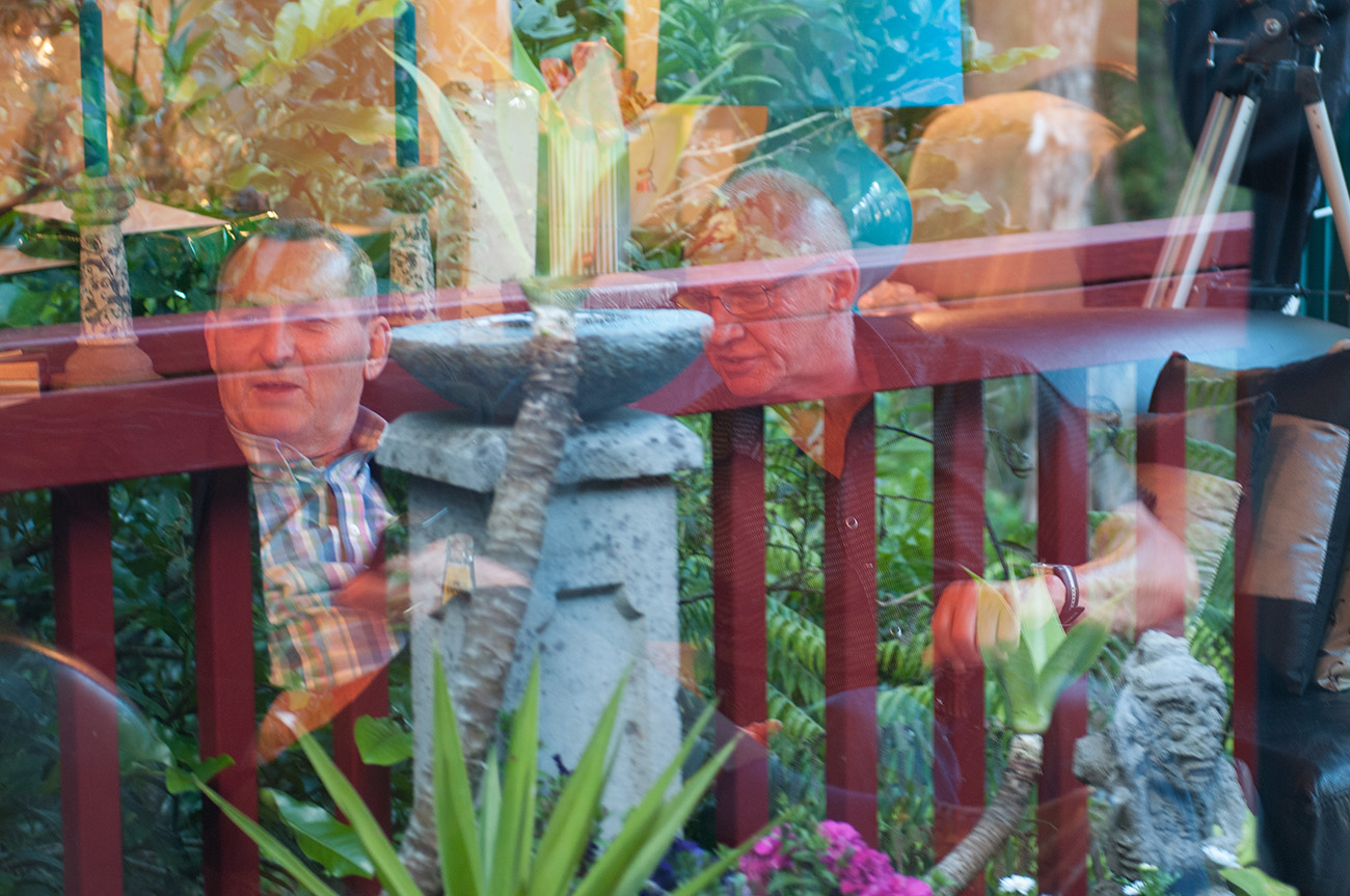 Glass reflections of wedding guests Homosexual Home garden Wedding Auckland Photographer Anais Chaine