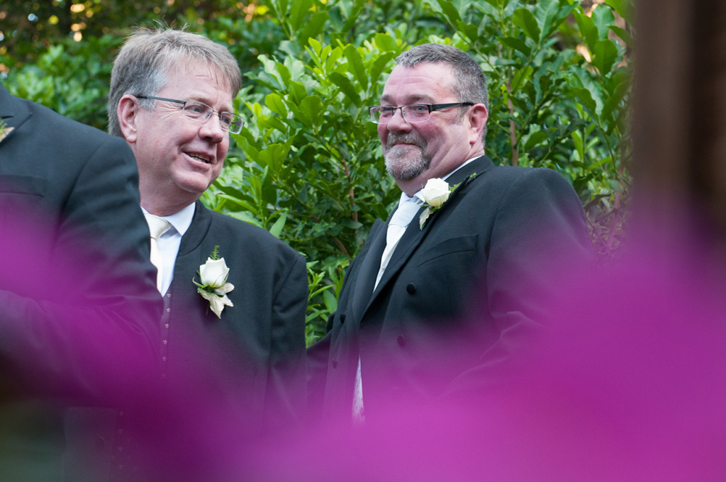 The groom stifles a laugh Homosexual Home garden Wedding Auckland Photographer Anais Chaine