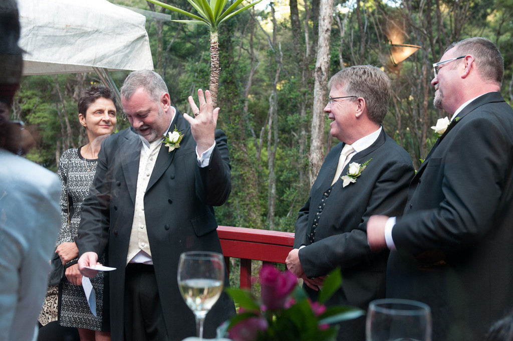 Groom showing ring and reading vows Homosexual Home garden Wedding Auckland Photographer Anais Chaine