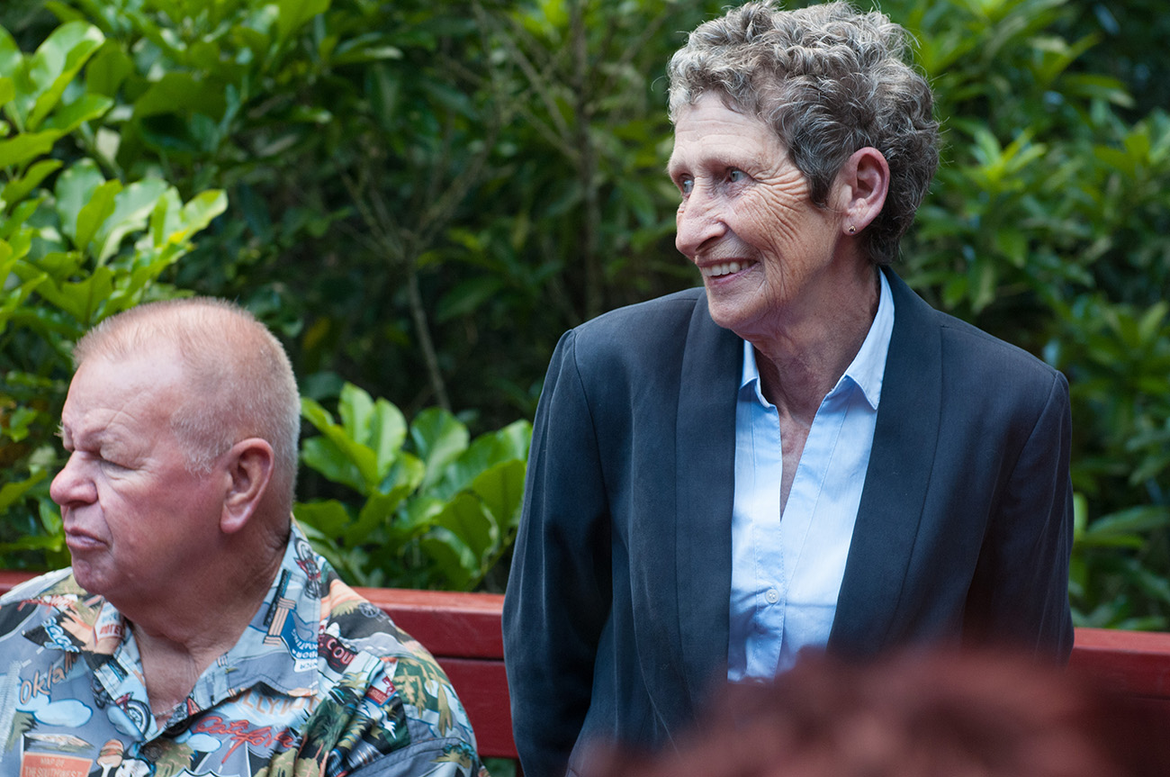Guests smile as they watch the ceremony Homosexual Home garden Wedding Auckland Photographer Anais Chaine