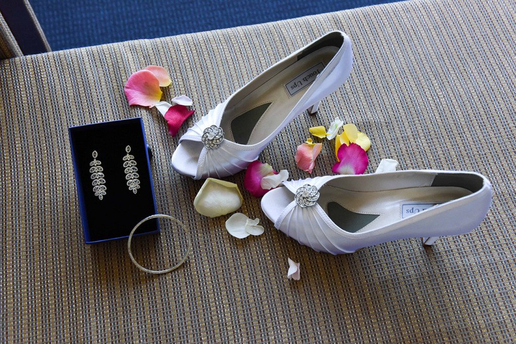 wedding photographer, Takapuna Auckland composition of rose petals and bride's shoes and jewellery