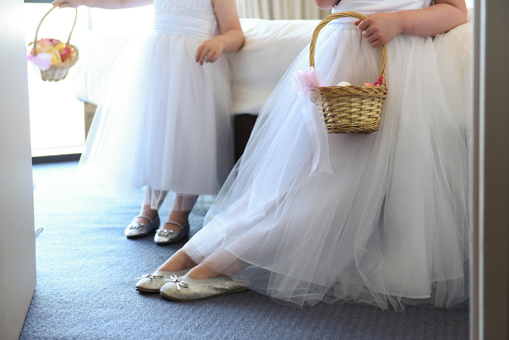 wedding photographer Takapuna half-cropped flower girls wearing their white dresses holding baskets