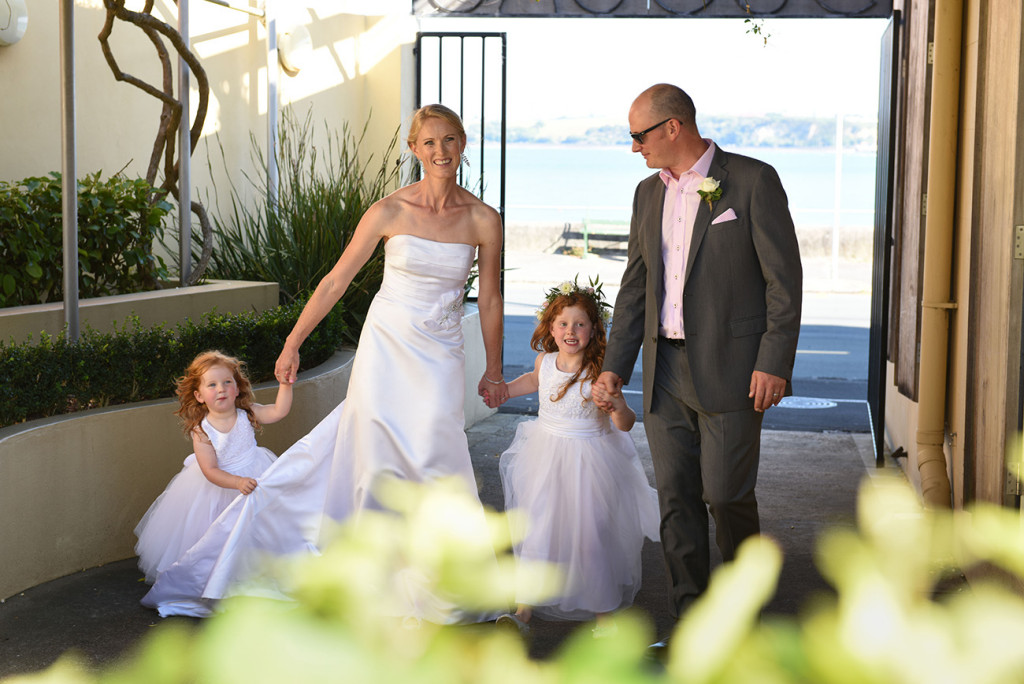 wedding photographer Devonport Duder's the bride and groom are walking with their daughters family