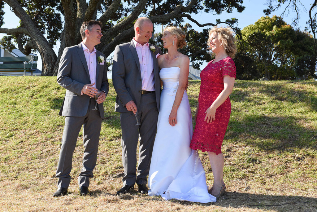 Devonport Duder's the bride and groom pose with their bridal party laughing together