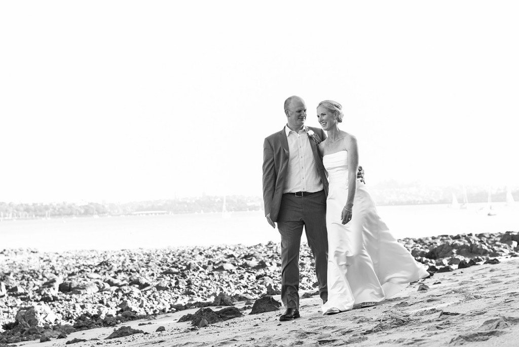 wedding photographer Devonport black and white the bride and groom strolling at the beach