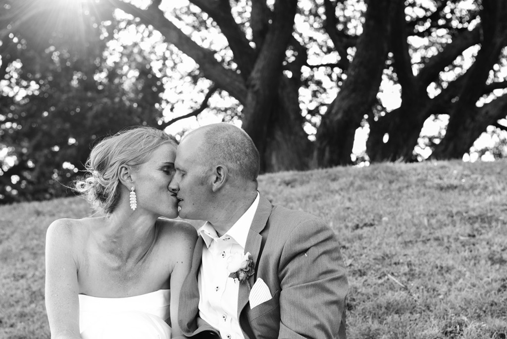 wedding photographer, Devonport, Duder's, black and white, the bride and groom tenderly kiss