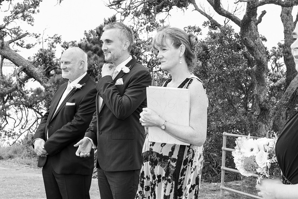 The groom the best man and the celebrant looking at bride's arrival