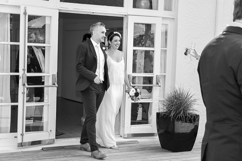 Hand in hand the bride and groom arriving at the reception wedding photographer