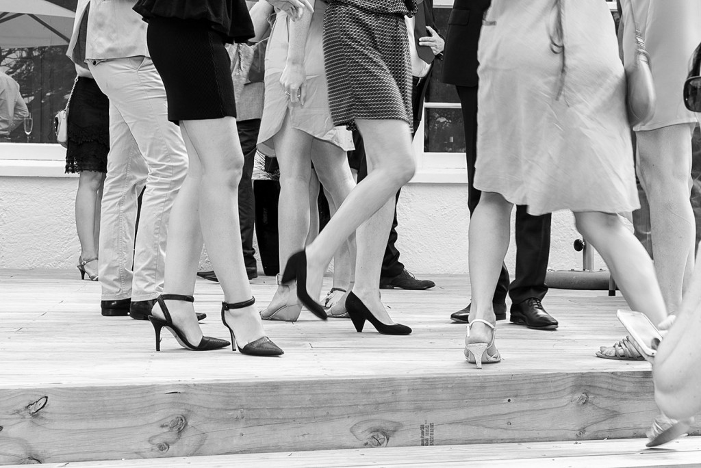 Half cropped of guests' legs black and white