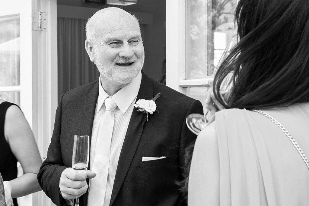 A glass of bubbles in hand, the best man smiling