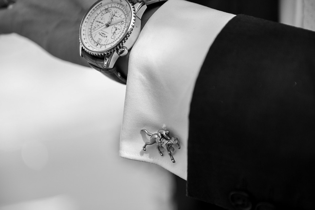 Watch and horserider cufflink of the groom's wedding suit