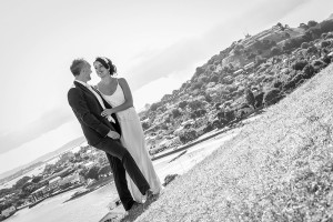 Moment of complicity of the bride and groom in a beautiful landscape