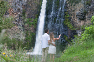Lovers observing the beauty of the falls and the nature around she pointing out something far away