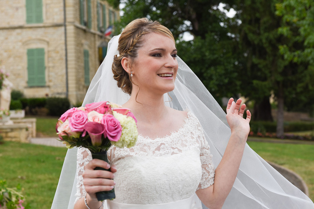 The bride shining with happiness her bouquet in her hand