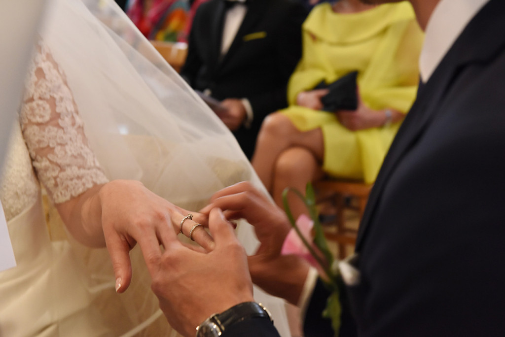 Half cropped of the bride and groom's hand during the groom during the exchange of rings