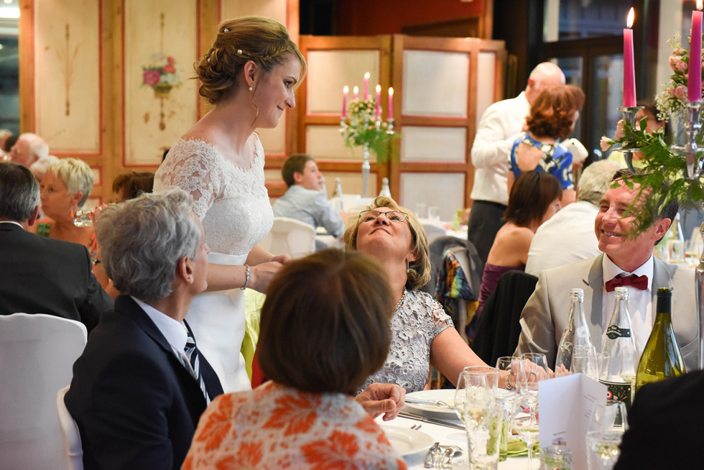 The bride laughing with her guests during the reception