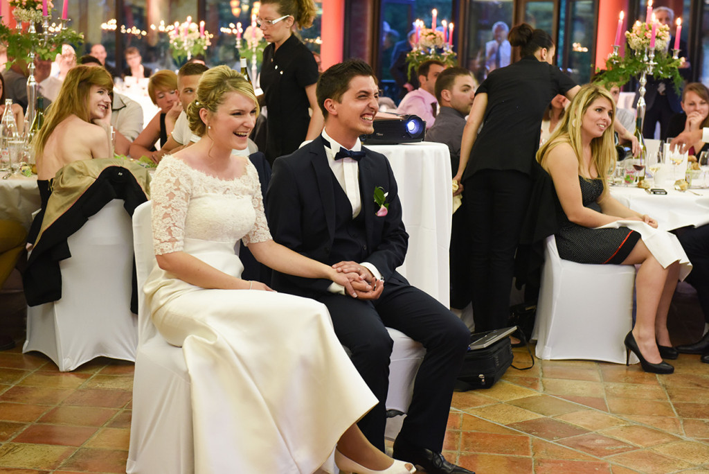 The bride and groom laughing during speechs