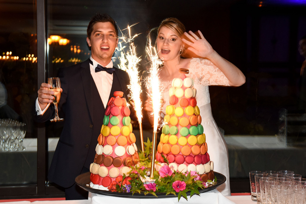 The bride and groom and their wedding cakes
