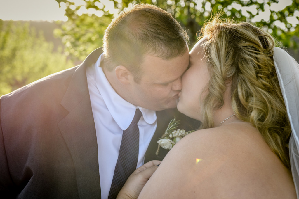 Bride and groom share a passionate kiss