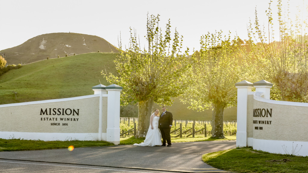 Bride and groom in front of Mission Estate Winery