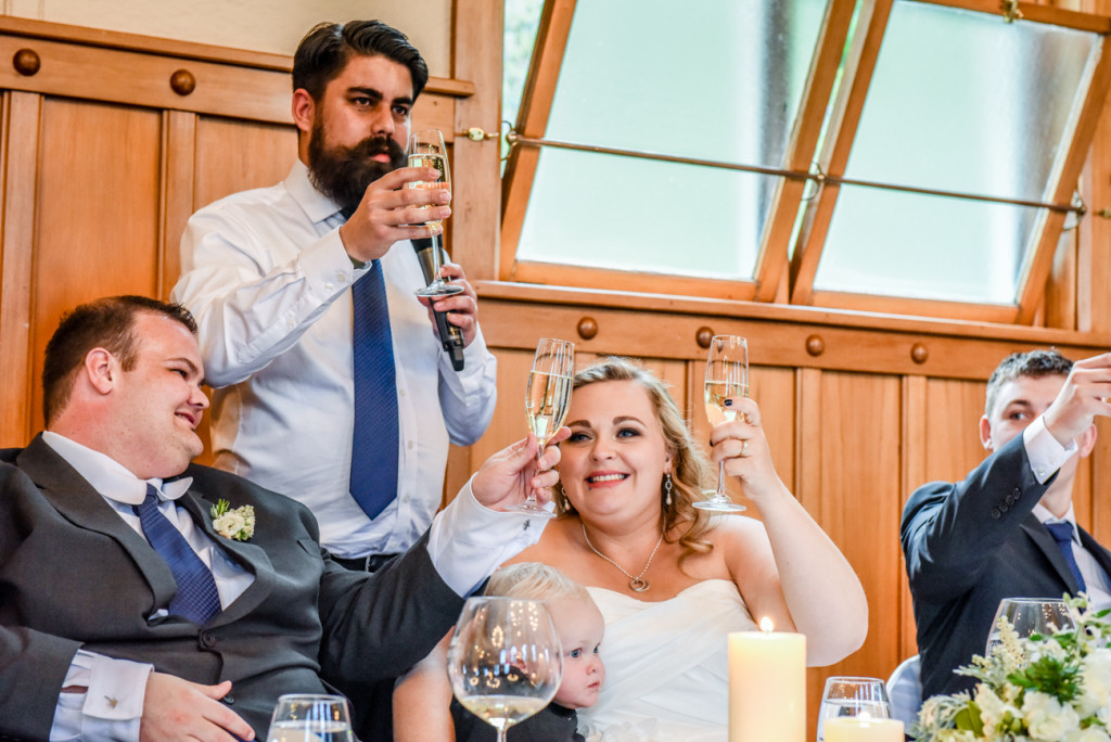 Bestman proposes a toast to the newly married couple