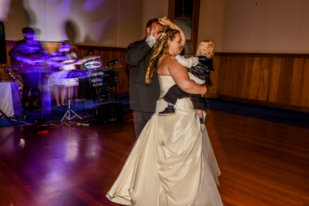 Bride, groom and son share their first dance