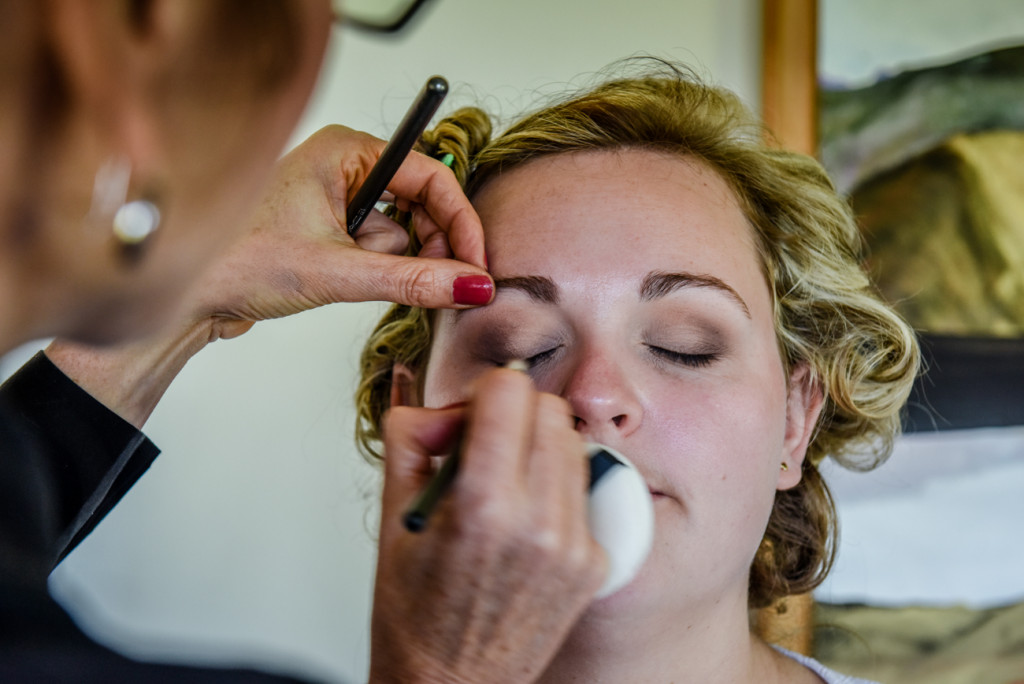 The bride's eyeshadow being touched up by Jodie Brenstrum