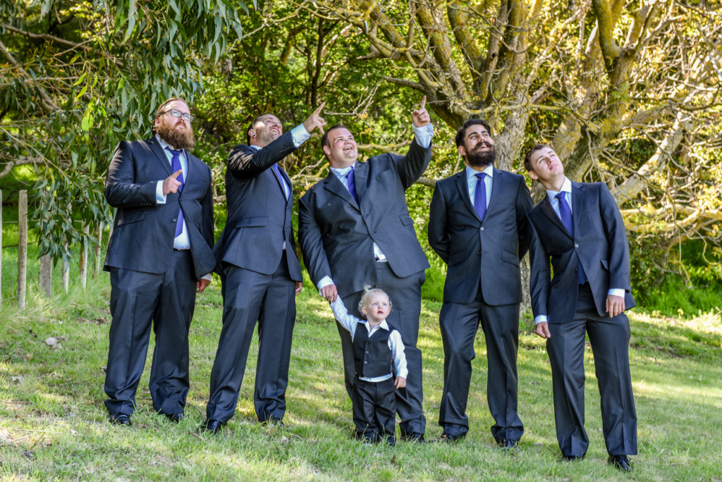 Groom, groomsmen and mini groomsman in the gardens at the Mission Estate Winery