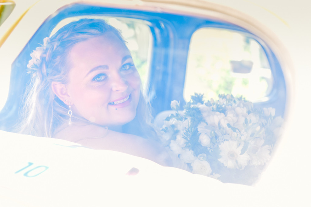 Bride through car rear