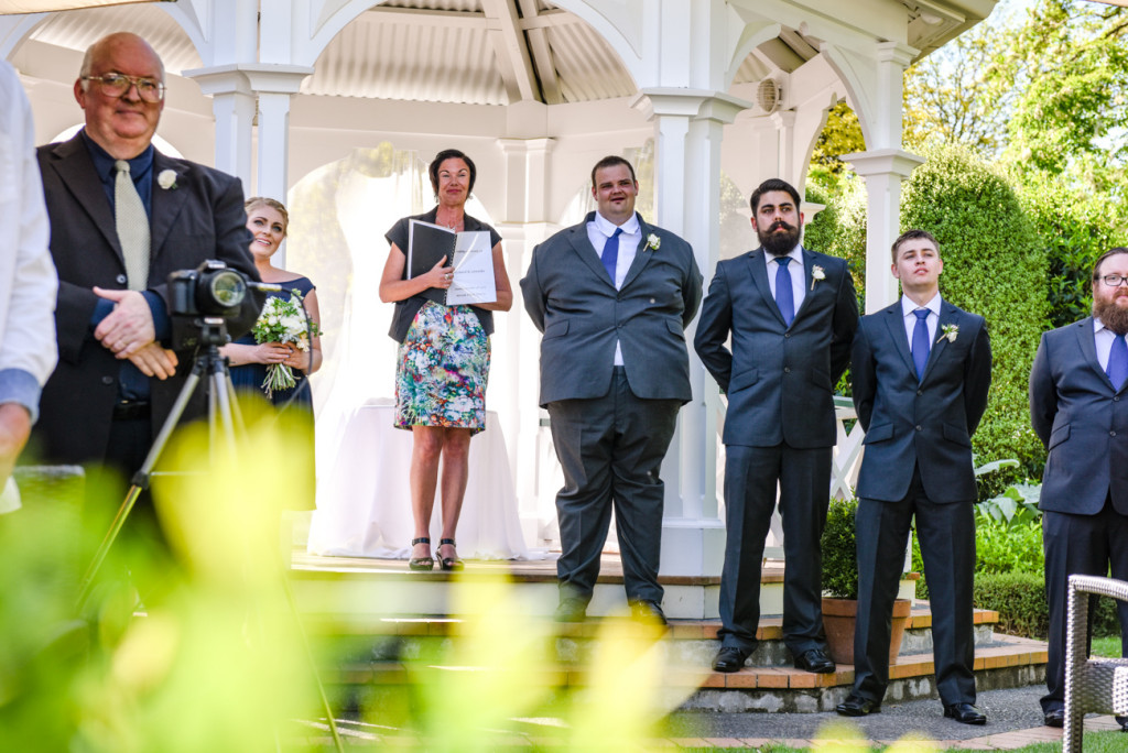 The groom and groomsmen waiting at the aisle