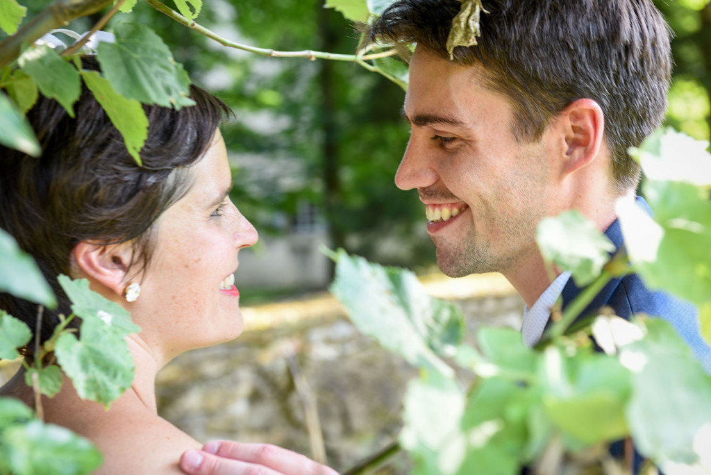 Close-up couple in vineyard at photoshoot outdoor French Wedding in Pranemoux Castle France