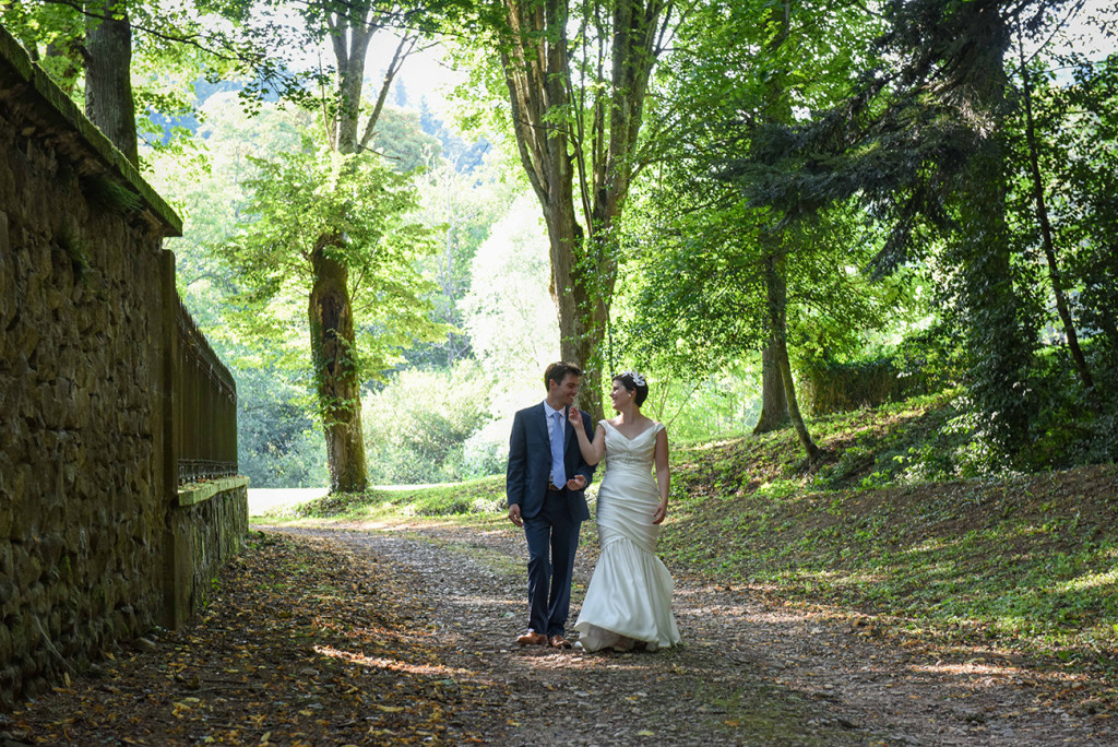 Bride and groom at photoshoot at their outdoor French Wedding in Pranemoux Castle France