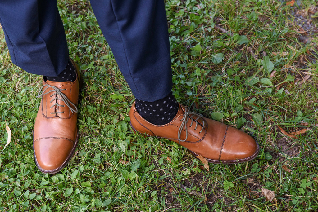 Closeup grooms brown oxford shoes at outdoor French Wedding in Pranemoux Castle France French photographer