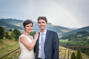 rainbow behind wedding couple