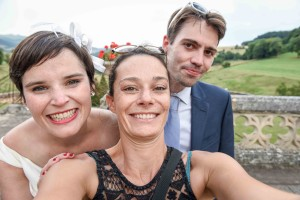 Yes : it is a selfie with the beautiful and happy couple!