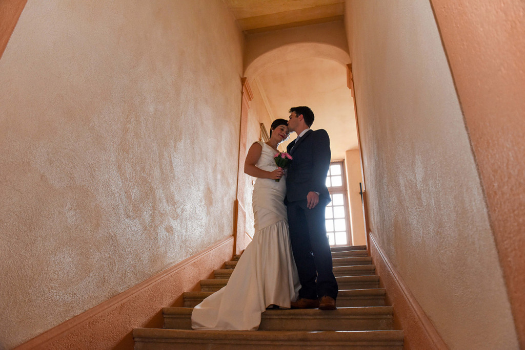 French couple at the top of the stairs in their French wedding at the Pranemoux Castle France