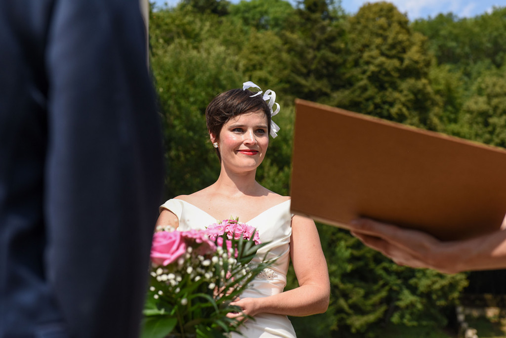 Bride at the altar at her French wedding in Pranemoux Castle France