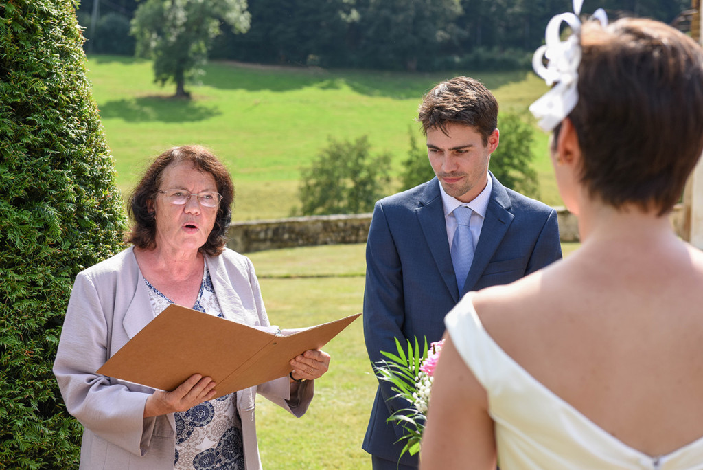 Celebrant officiating the Outdoor French Wedding in Pranemoux Castle France