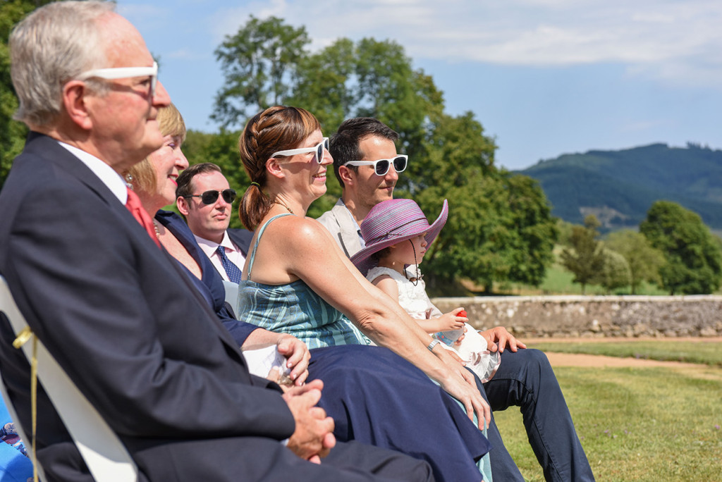 Guests onlooking the Outdoor French Wedding in Pranemoux Castle France