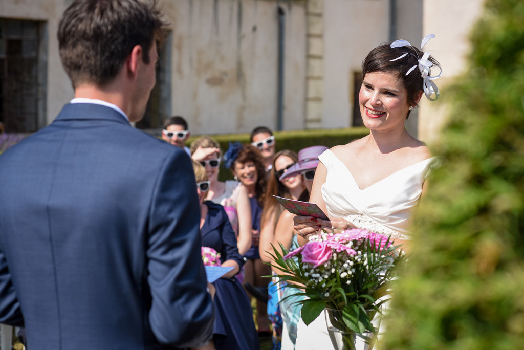 Couple exchanging vows at their Outdoor French Wedding in Pranemoux Castle France