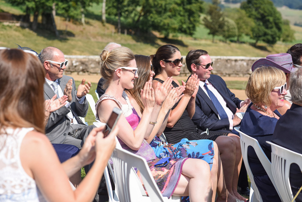 Guests clap for the couple at the outdoor French Wedding in Pranemoux Castle France