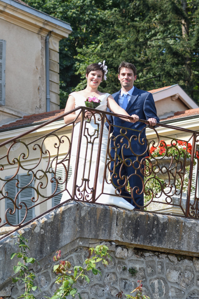 Newly married couple at roof of their outdoor French Wedding in Pranemoux Castle France