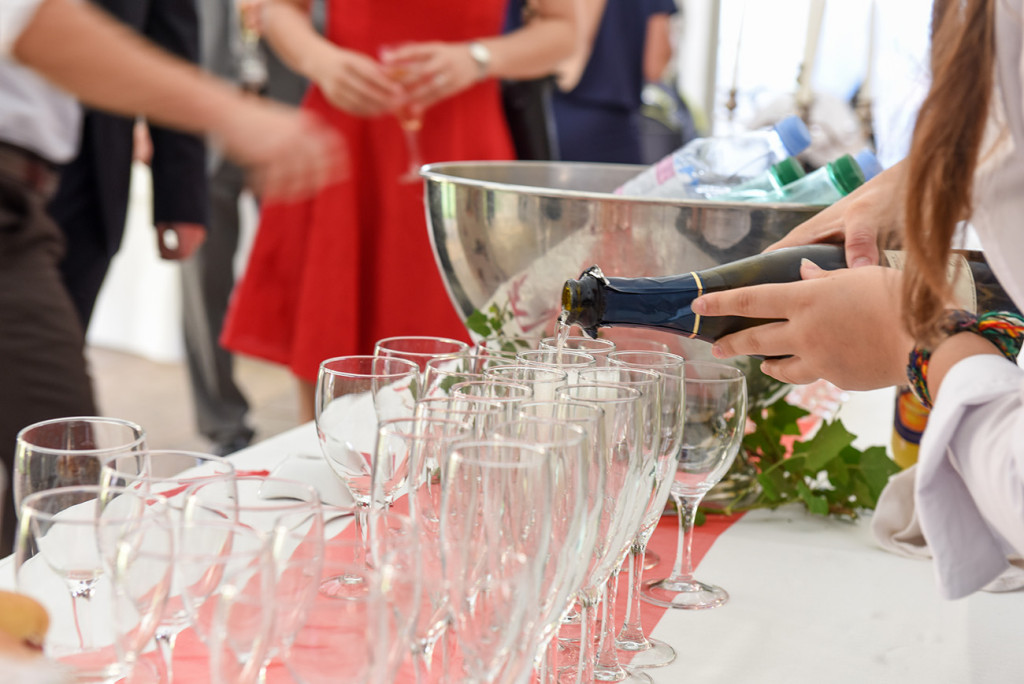 Champagne pour at the outdoor French Wedding in Pranemoux Castle France