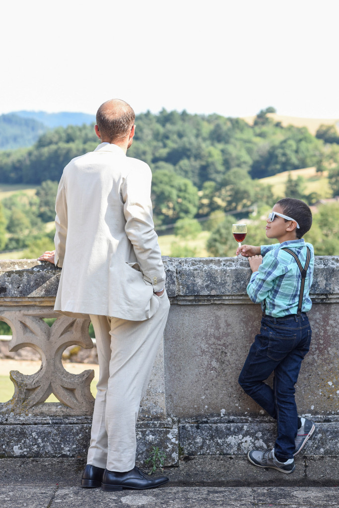 Cool boy with wine at the outdoor French Wedding in Pranemoux Castle France