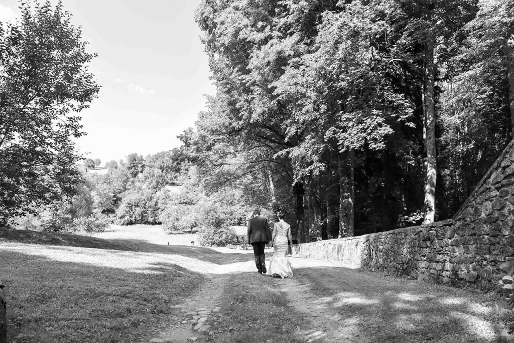Black and white newly married couple at photoshoot in outdoor French Wedding in Pranemoux Castle France French Photographer