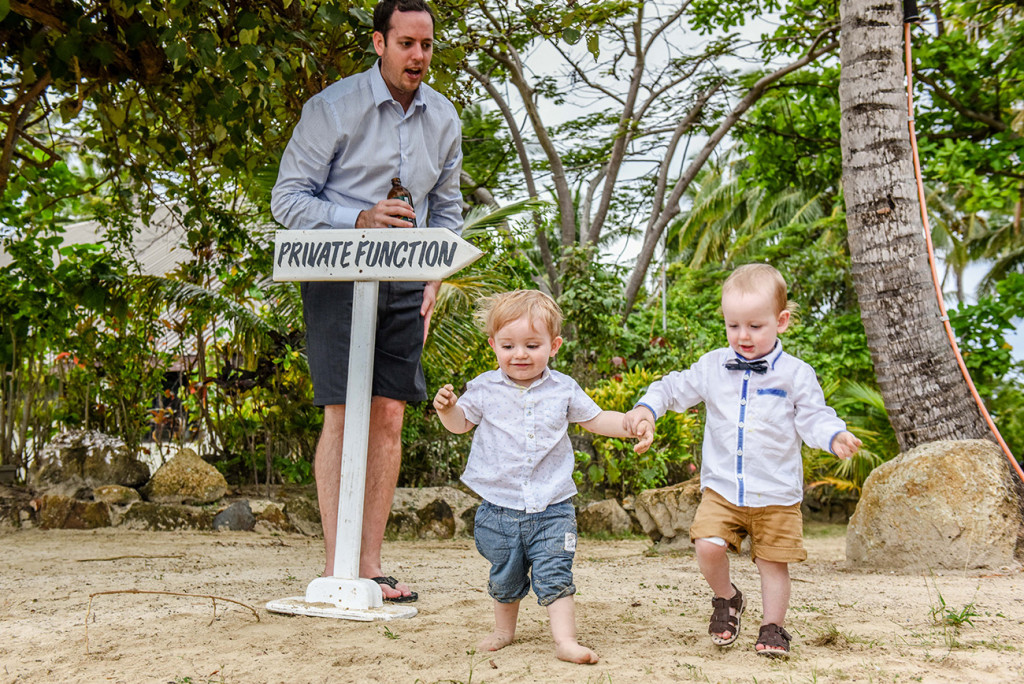 Toddlers walk in the sand at the family Beach Wedding on Malolo Island, Plantation Island Resort, Fiji Wedding Photographer